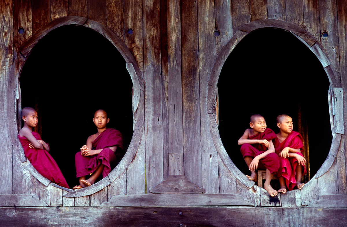 Shwe Yaunghwe Kyaung Monastery with the typical oval wi...