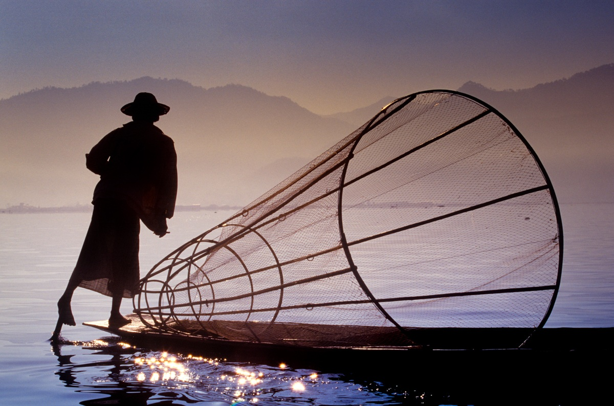 Inle Lake - Intha fisherman rows helping by the foot...