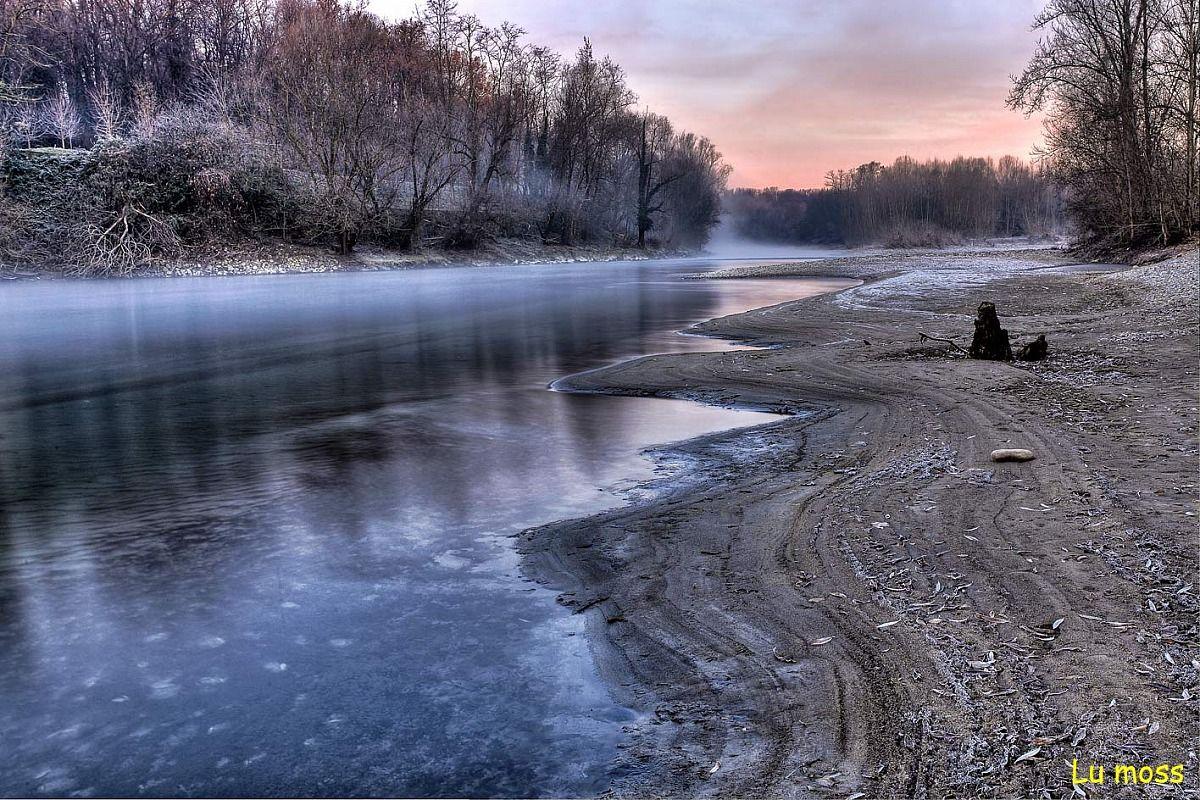Sunrise on the river Adda...