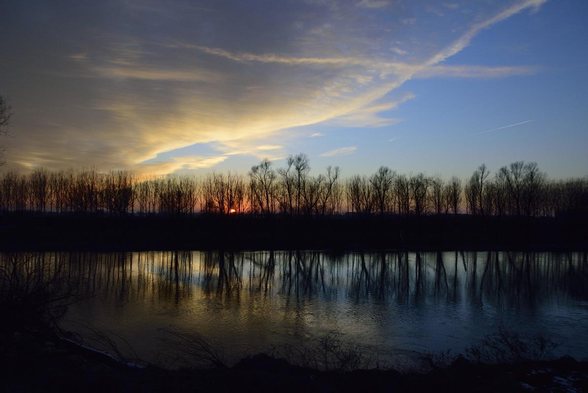 Tramonto e riflessi sul fiume Olio...