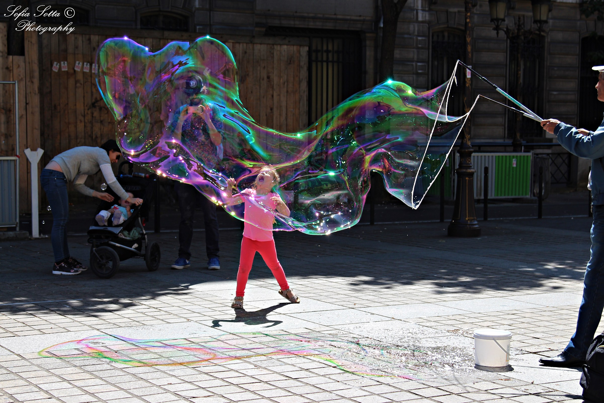 Little girl with bubble...