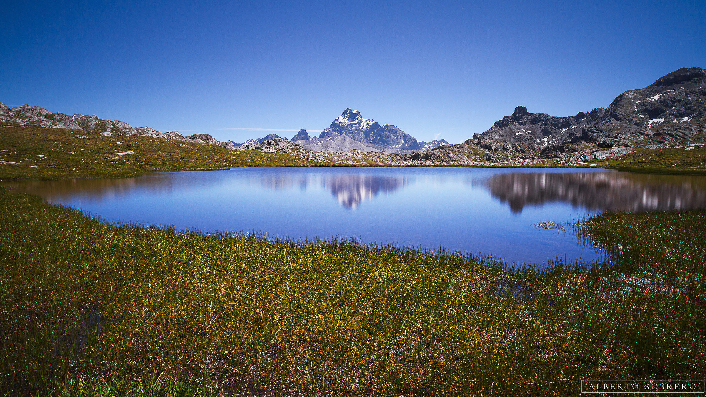 Viso Tour and Real are reflected in Lago Longet...