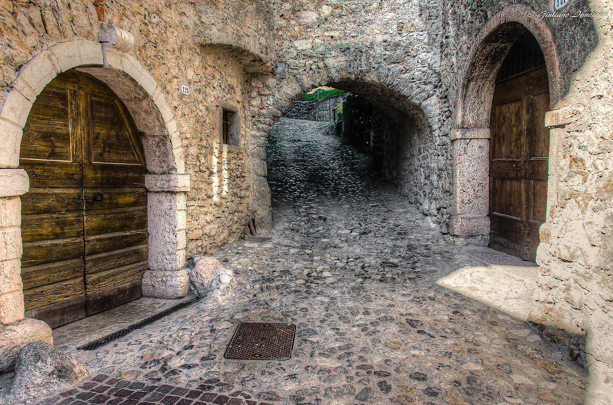 between medieval streets of the Borgo Borgo Canale...