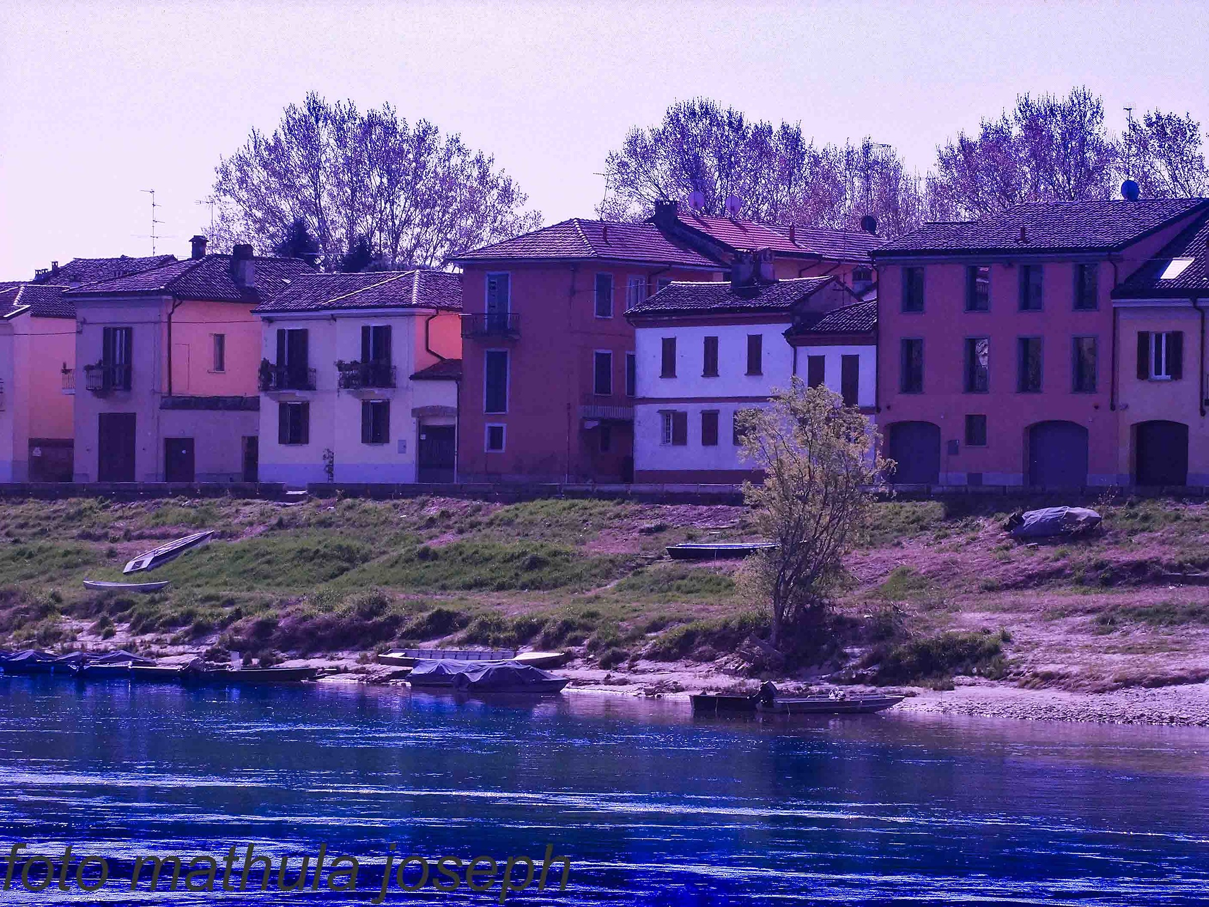 houses on the river Mincio in Pavia...