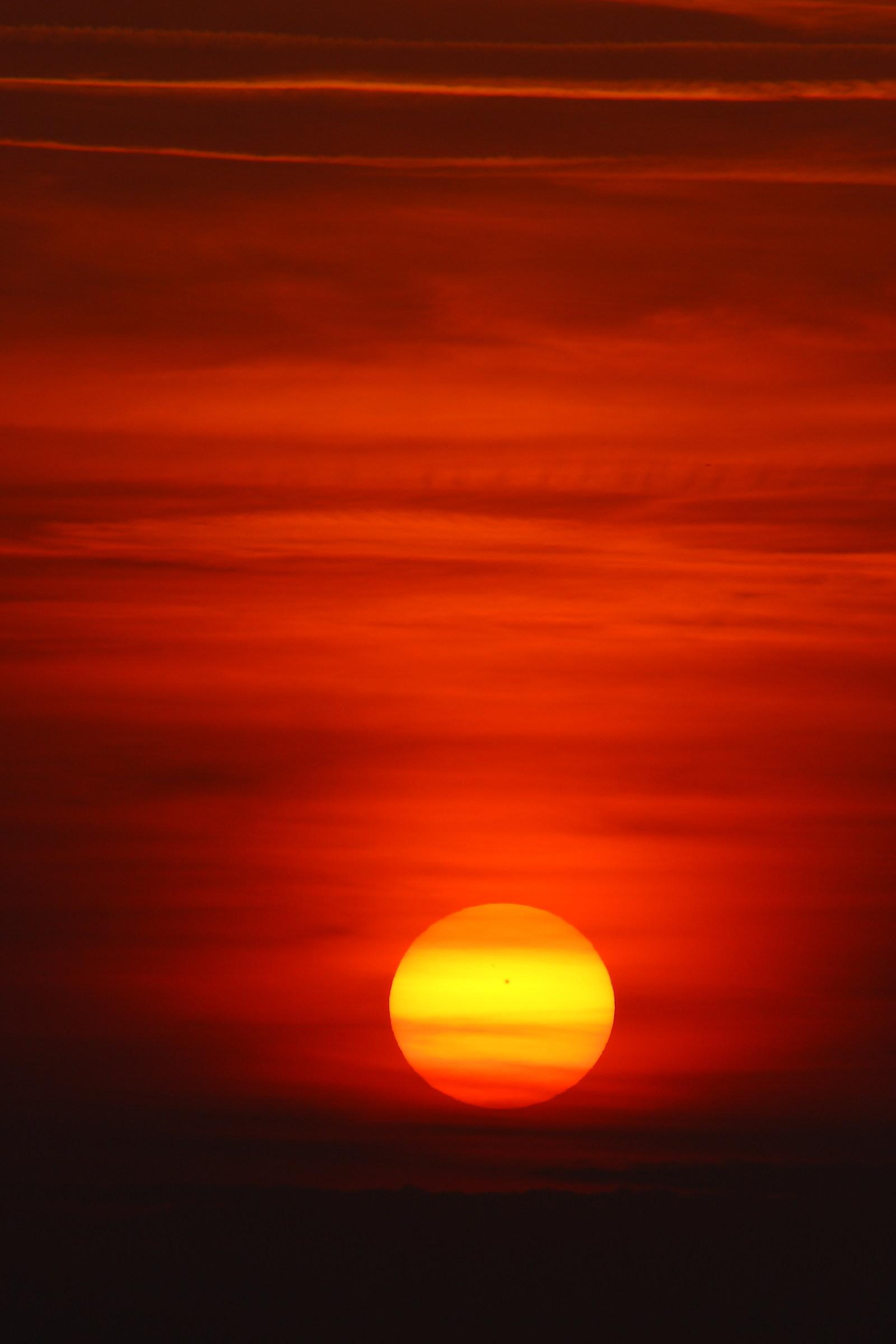 sun with black spot...