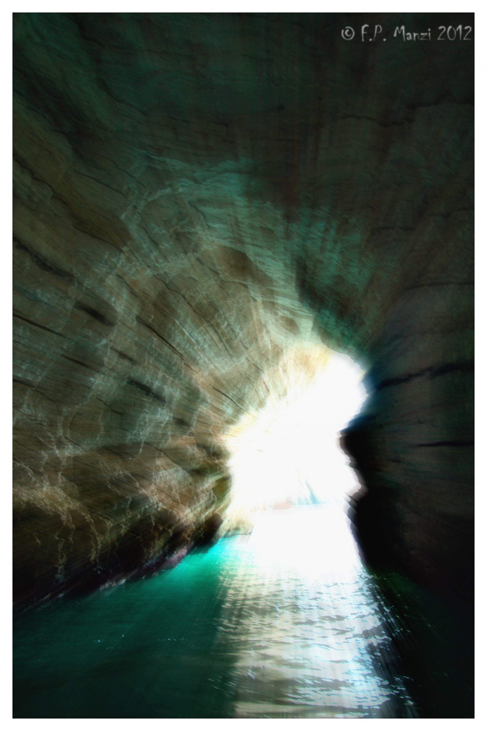 The light beyond the darkness in the caves of Vieste...