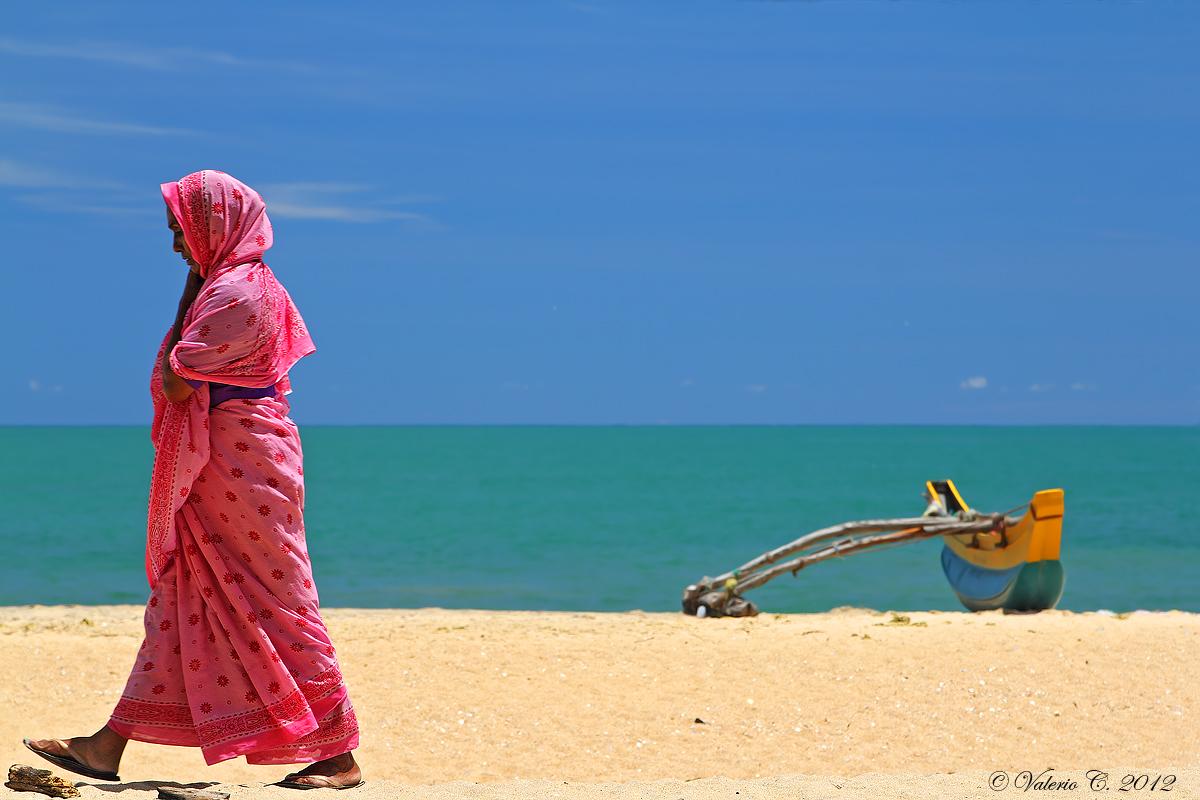 The woman with pink sari...