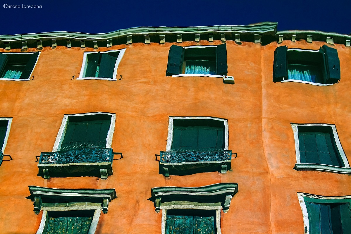 Buildings that are reflected in the lagoon of Venice...