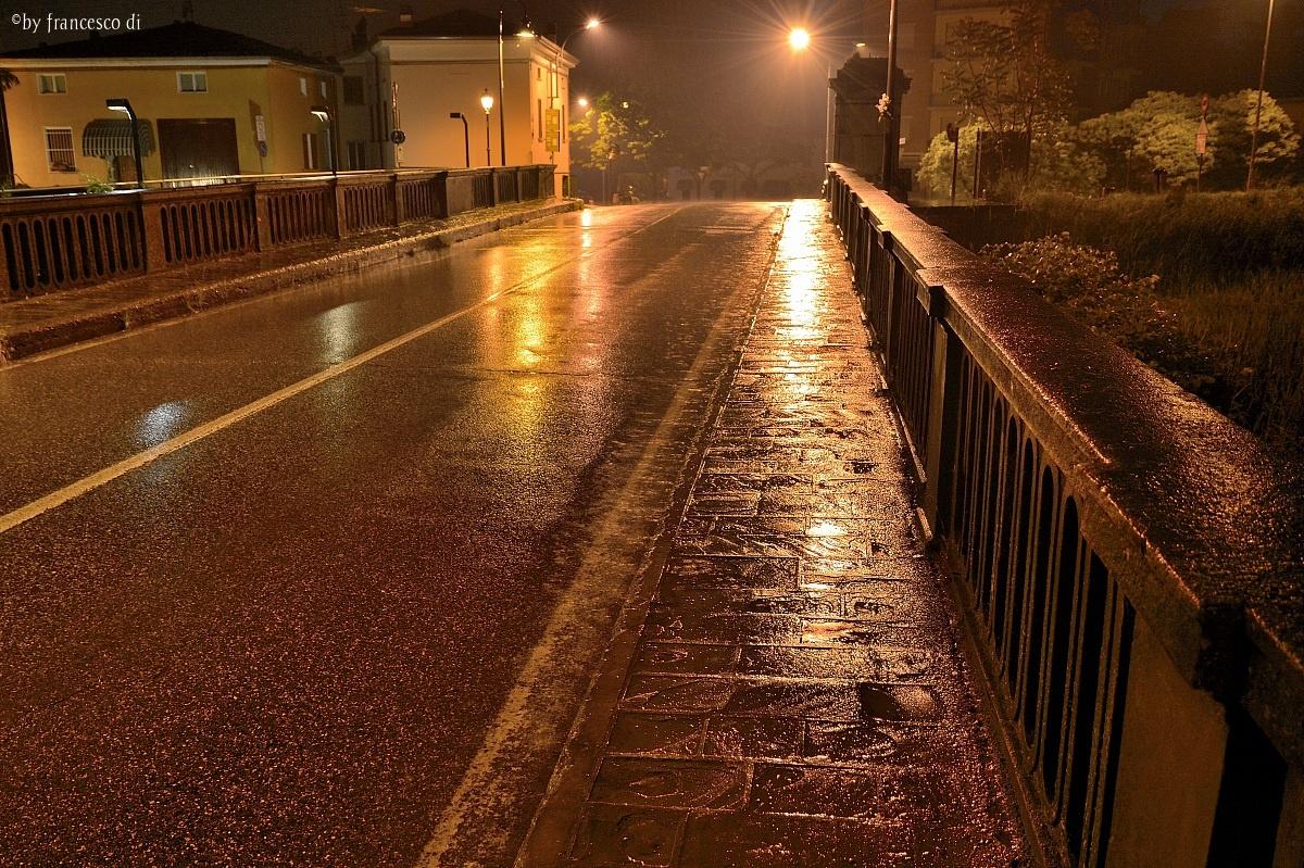 rainy night on the bridge by Colorno...
