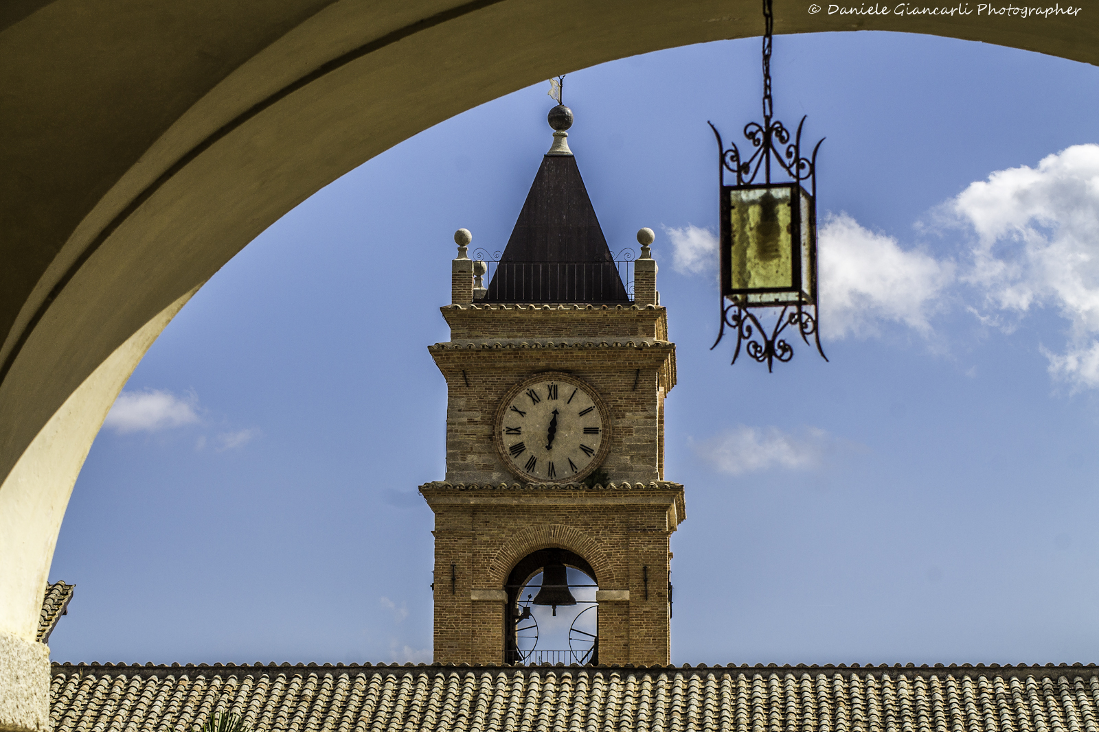 The bell tower under the arch...
