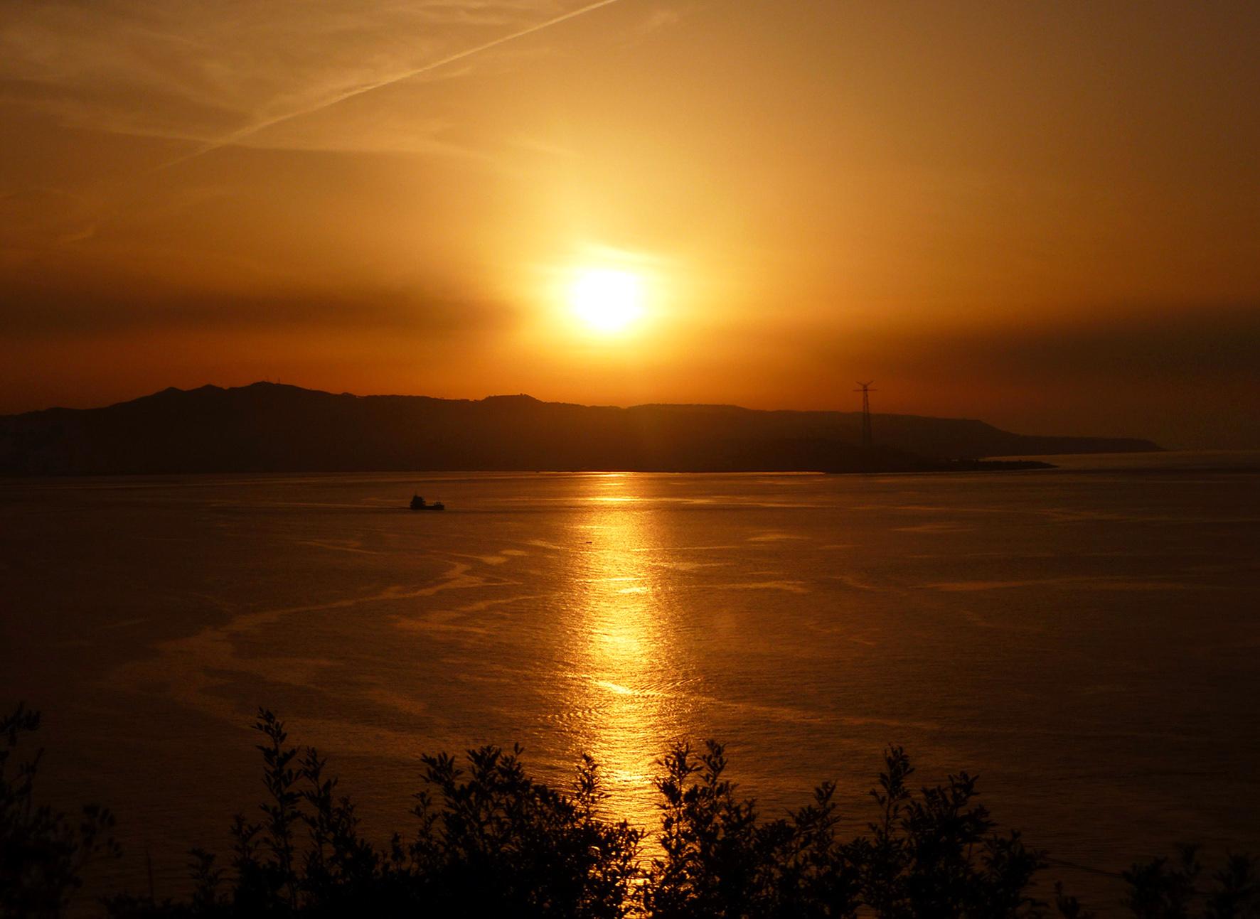 Golden sunset over the Strait of Messina...
