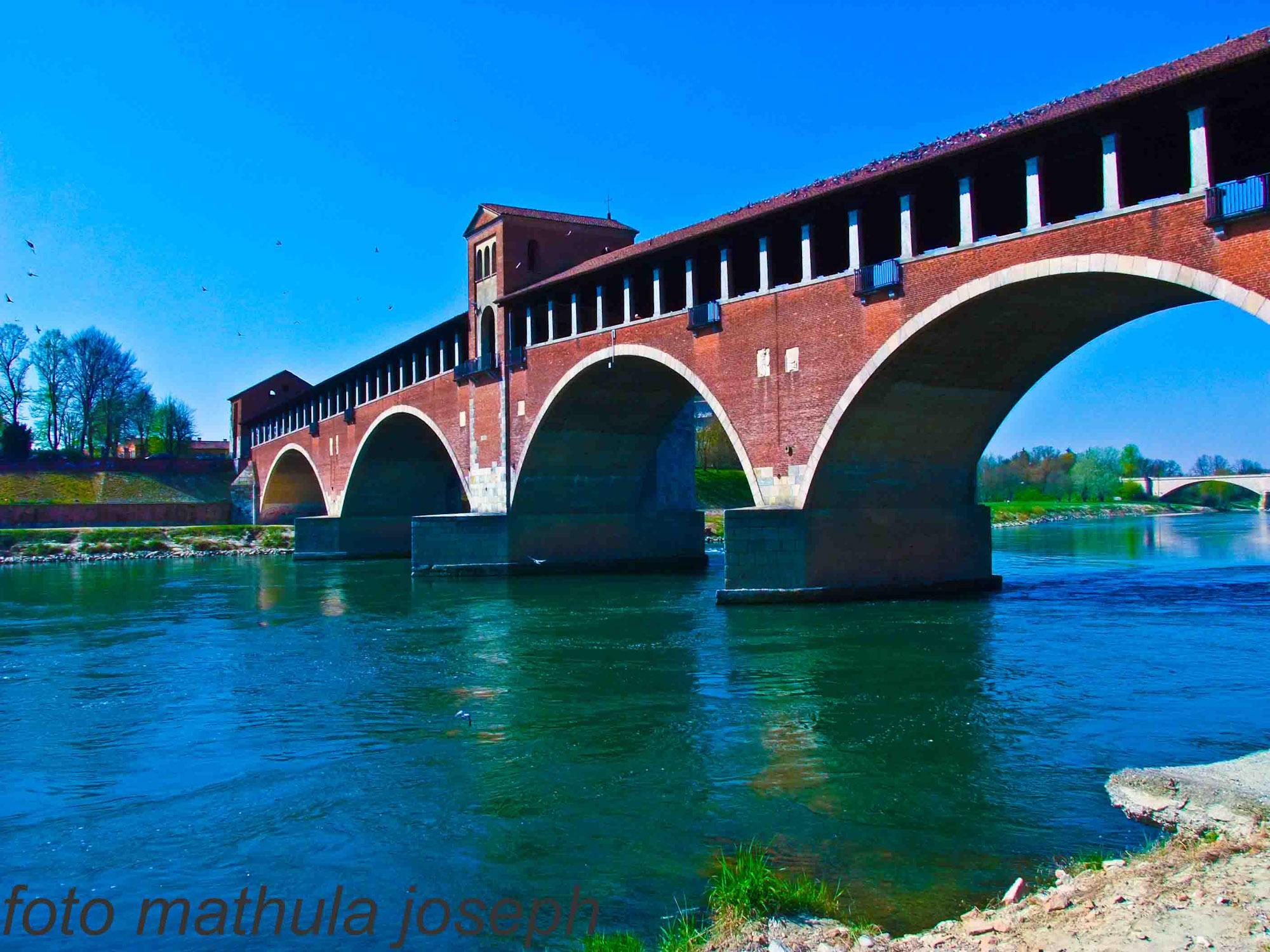 covered bridge on Ticino river in Pavia...