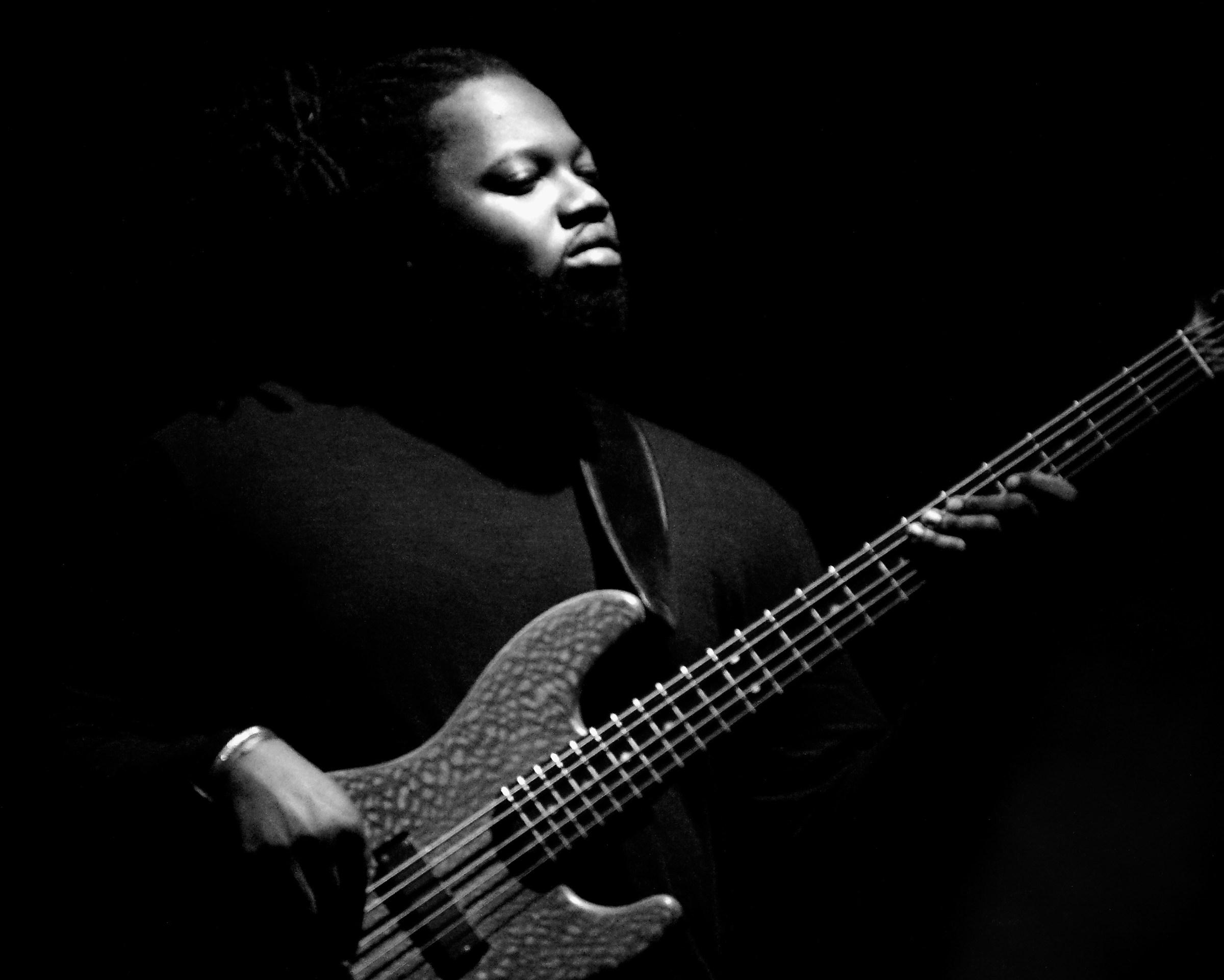 Bass guitar player...