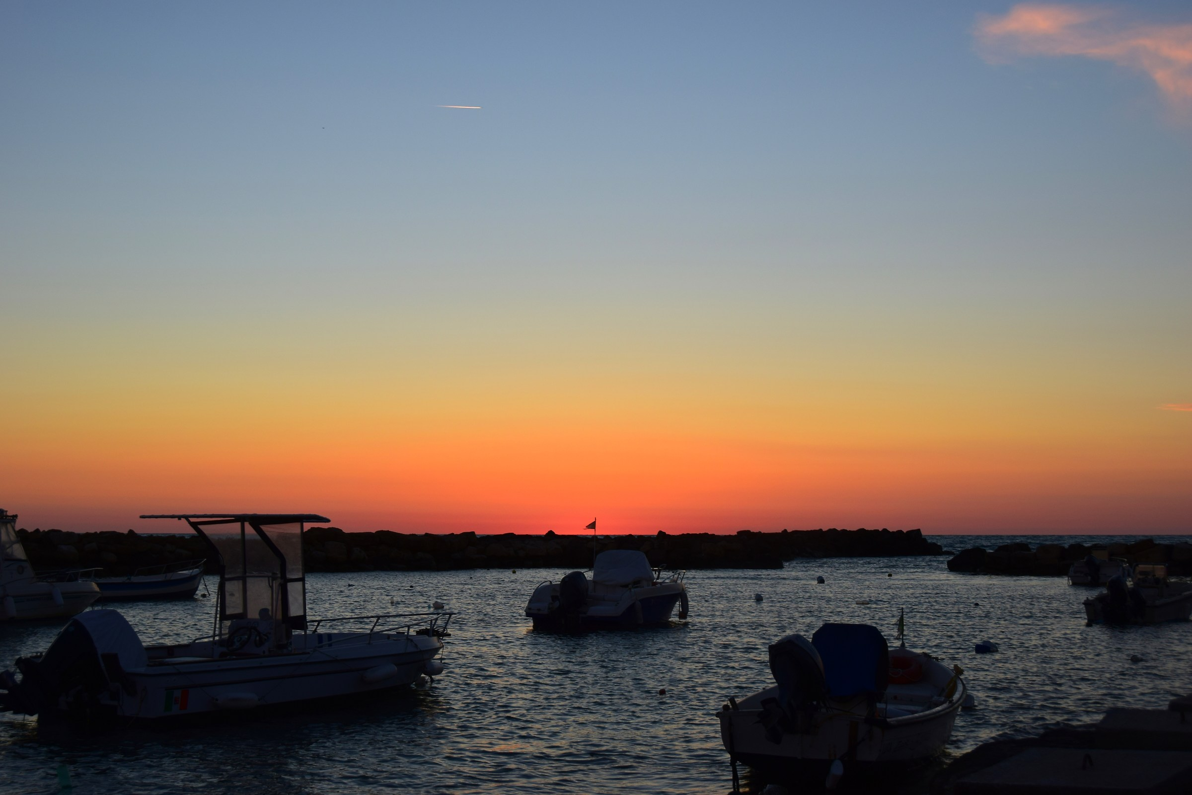sunset at the port of Punta Secca...