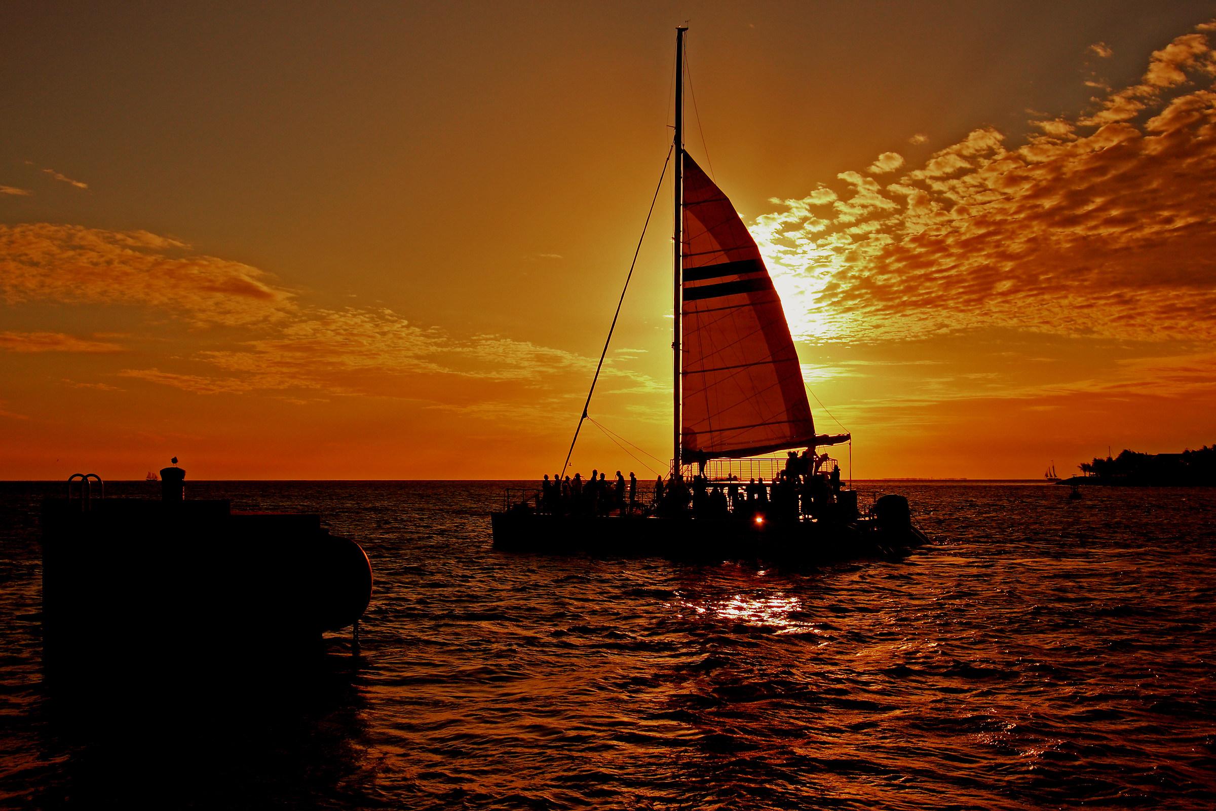the sun behind the sail...
