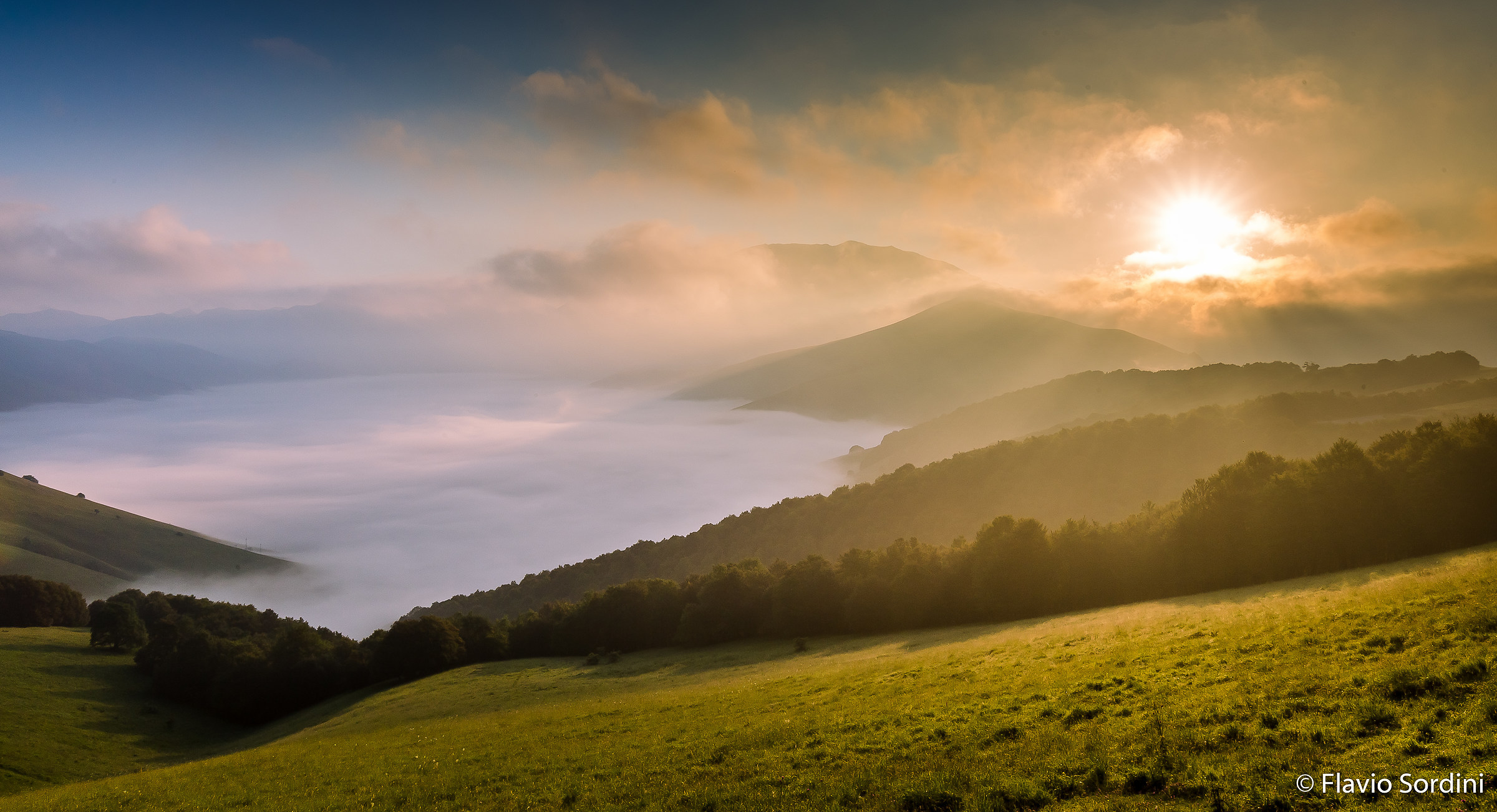 Alba between clouds and fog...