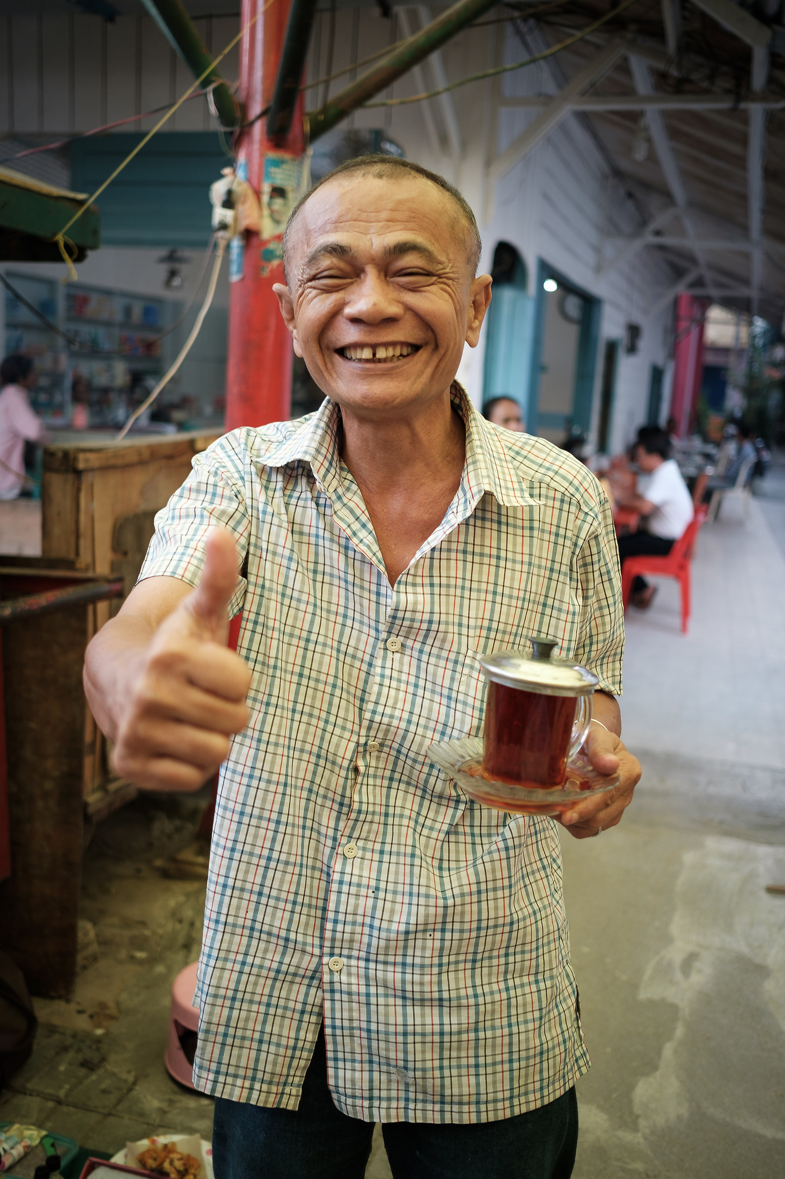 Indonesia- The faces in the markets - The bartender of Tea...