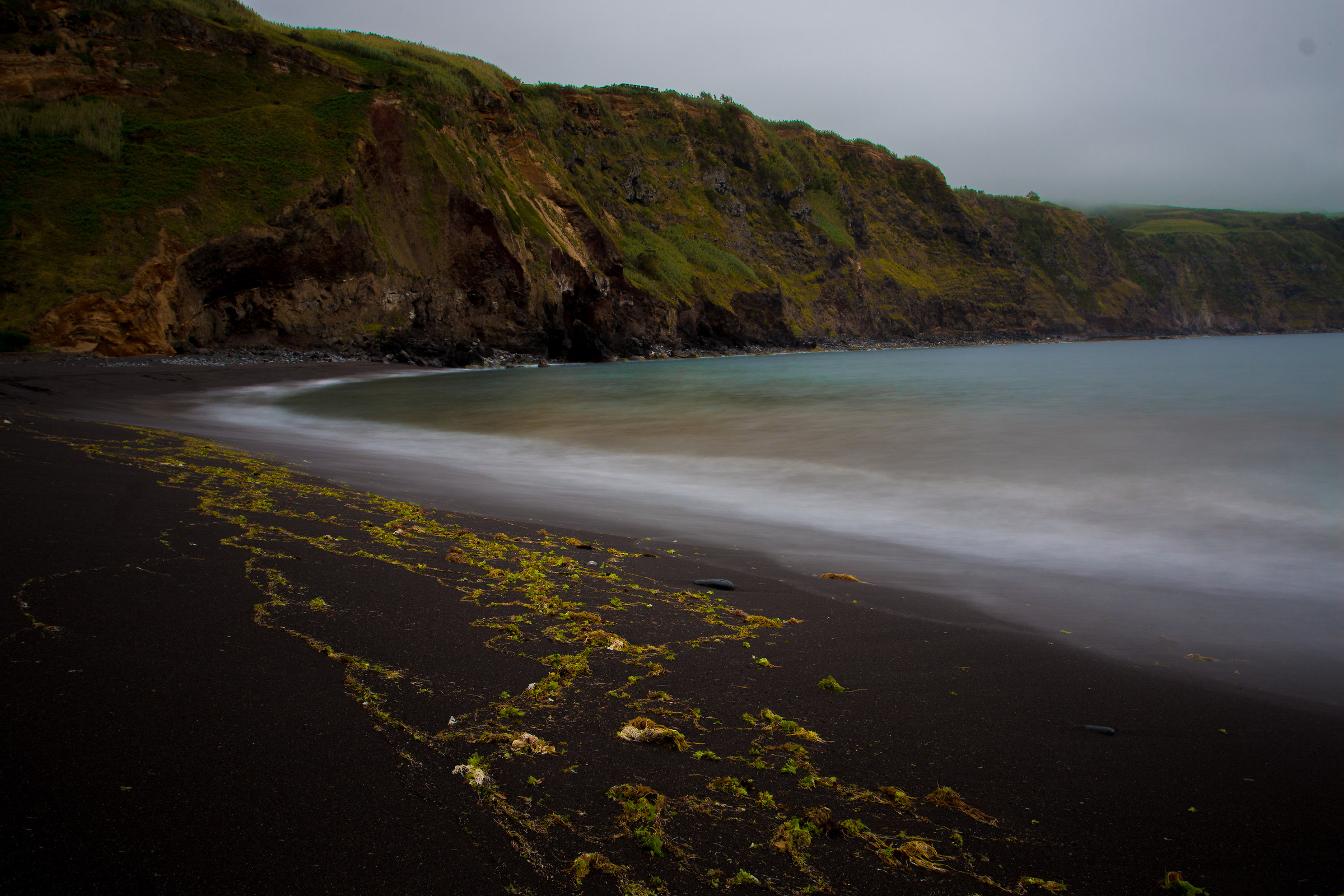 black sand and low clouds...