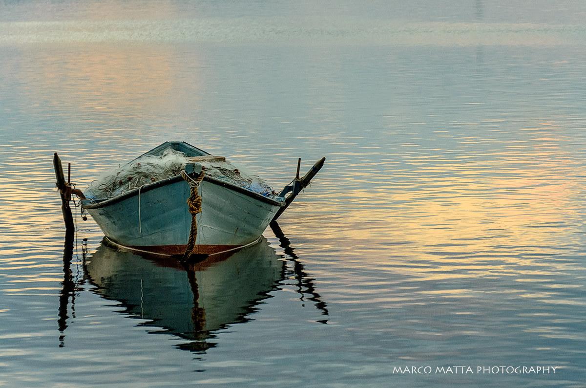 Barca in laguna al tramonto...
