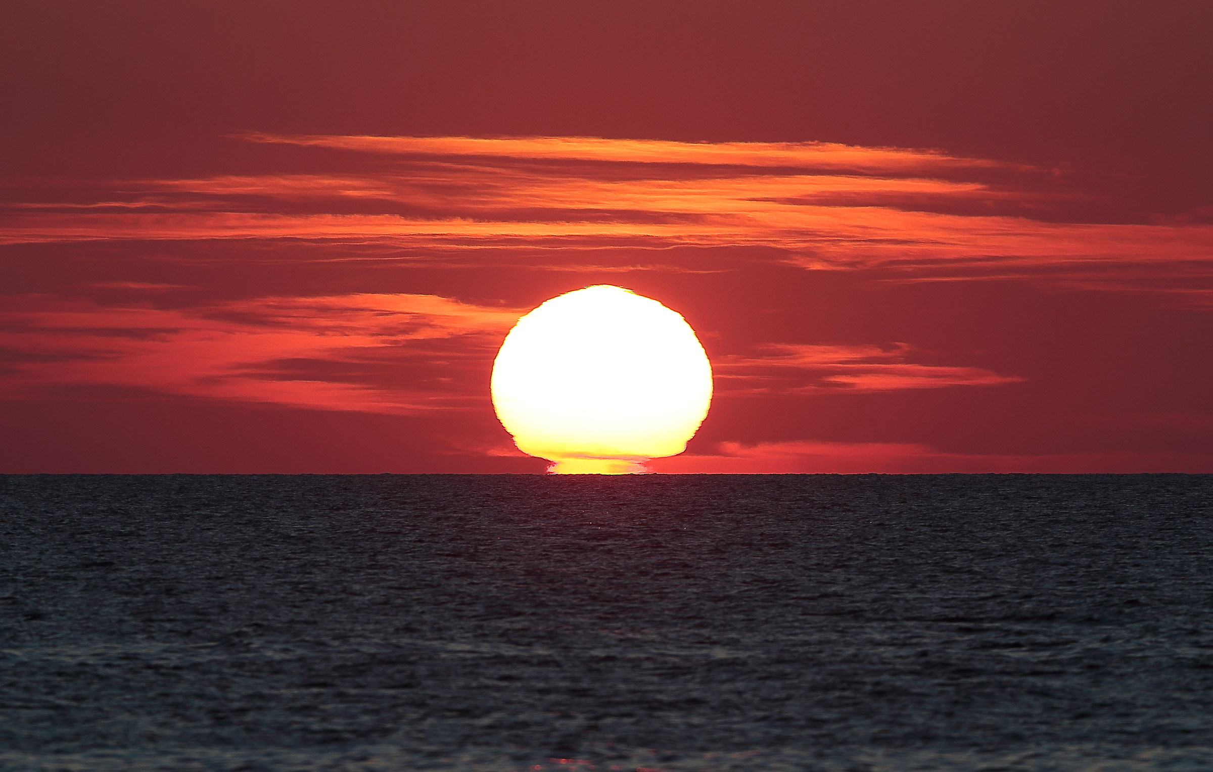 When the sun sinks into the sea...