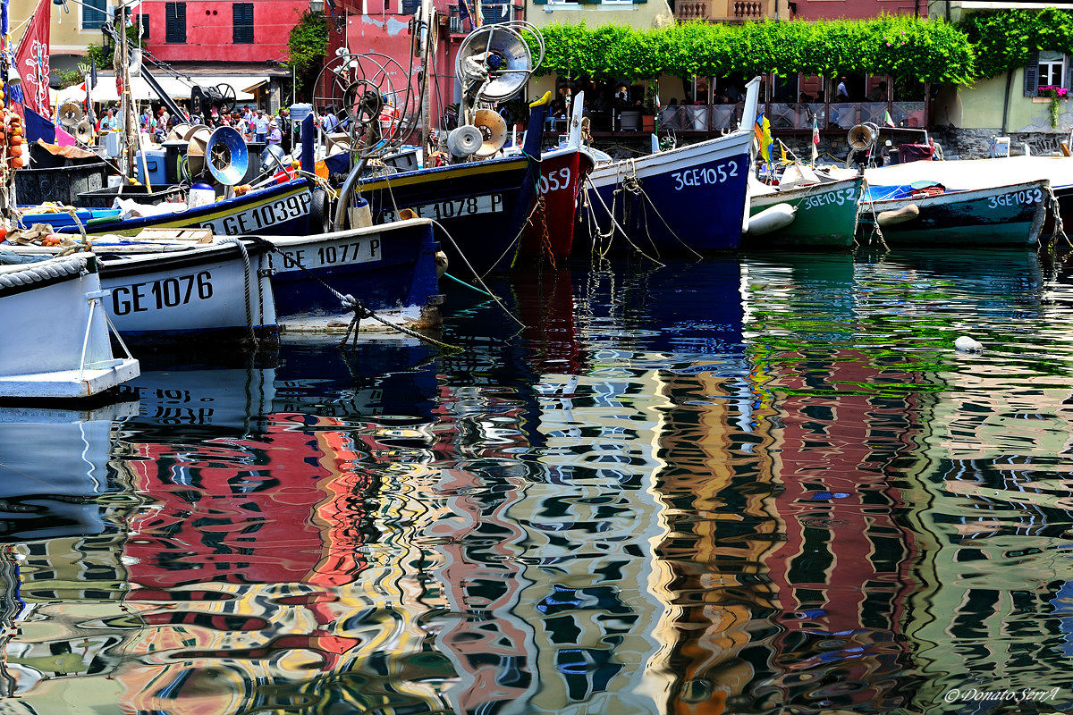 Boats and reflections in the port of Camogli...