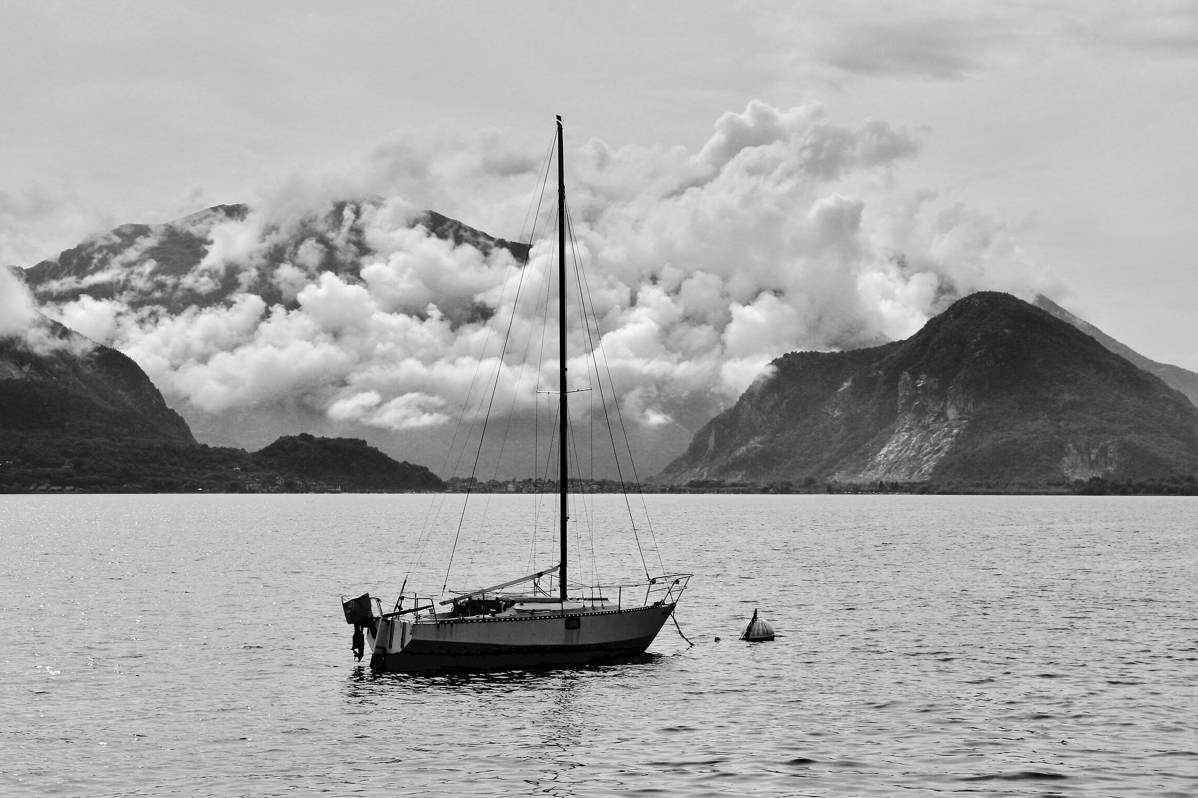 Verbania. Boat on lake (in b / w)...