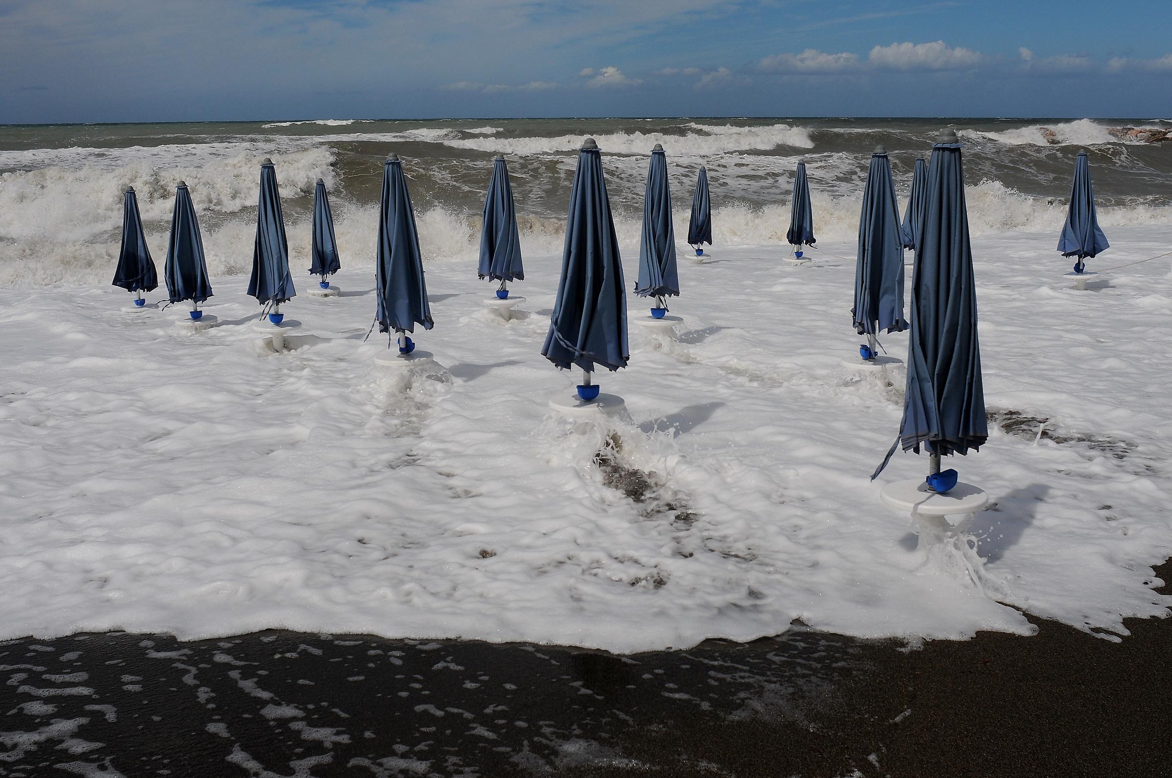 Beach umbrellas near the sea ......