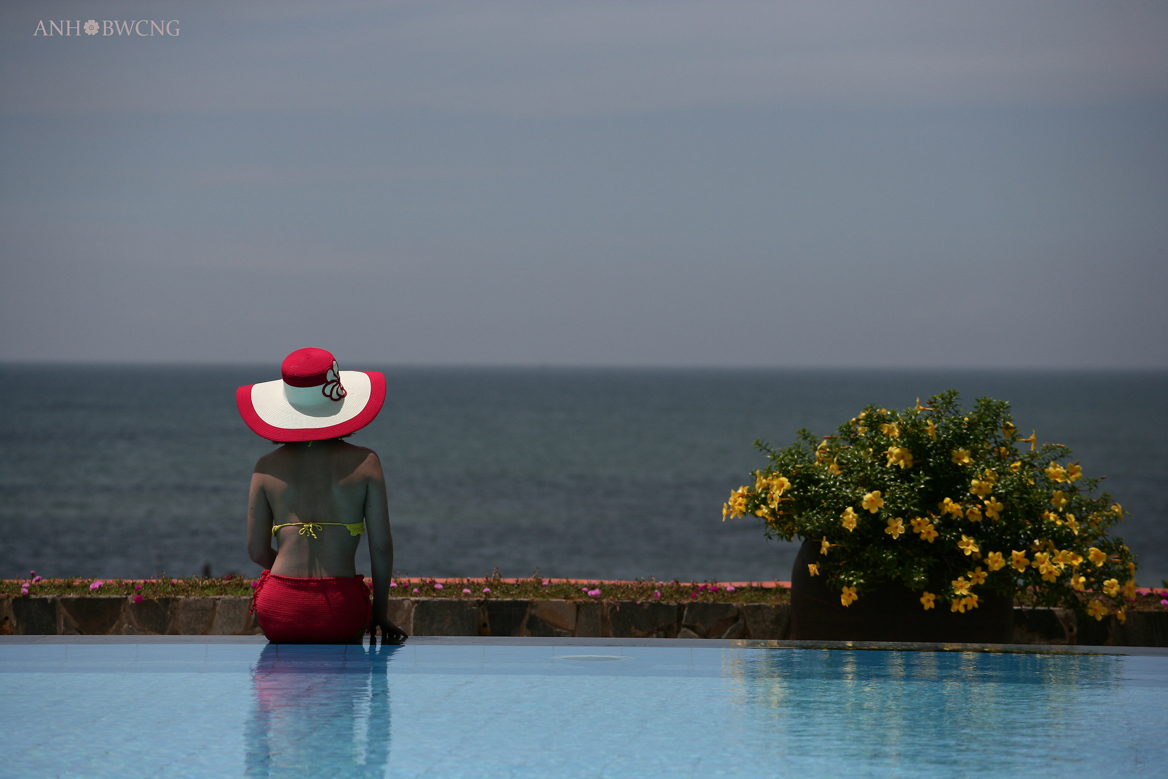 Red Hat In Front Of The Sea...