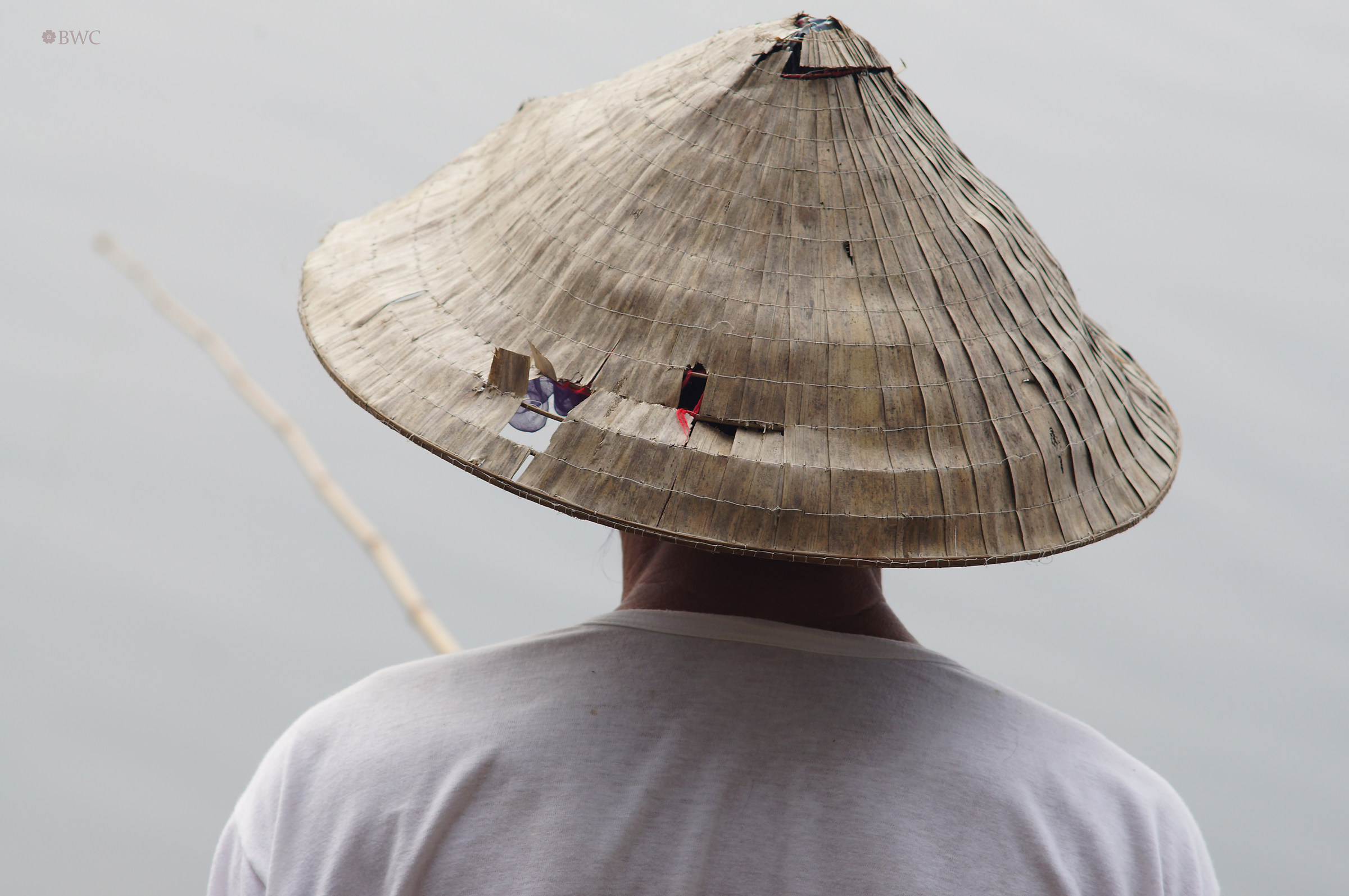Man In Traditional Hat Illegally Fishing...