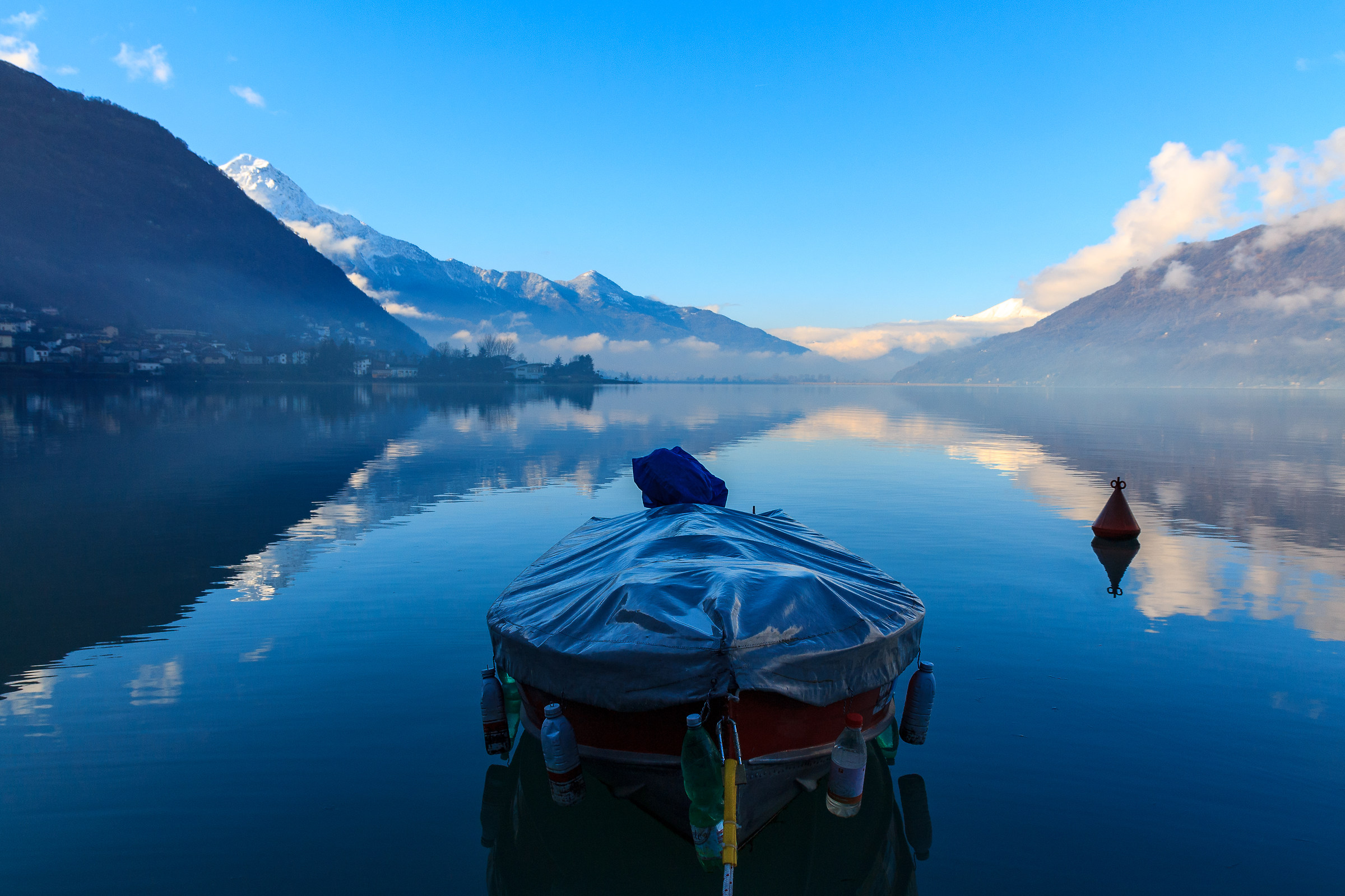 The boat floats in the blue...
