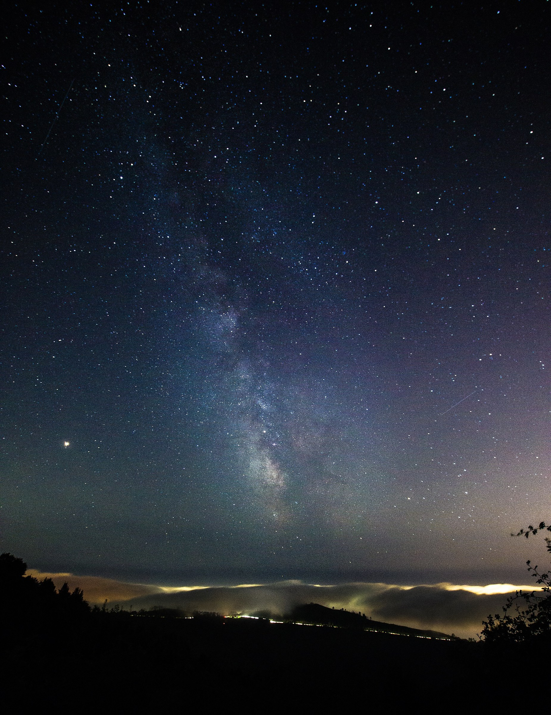The Milky Way over the clouds of Genoa...