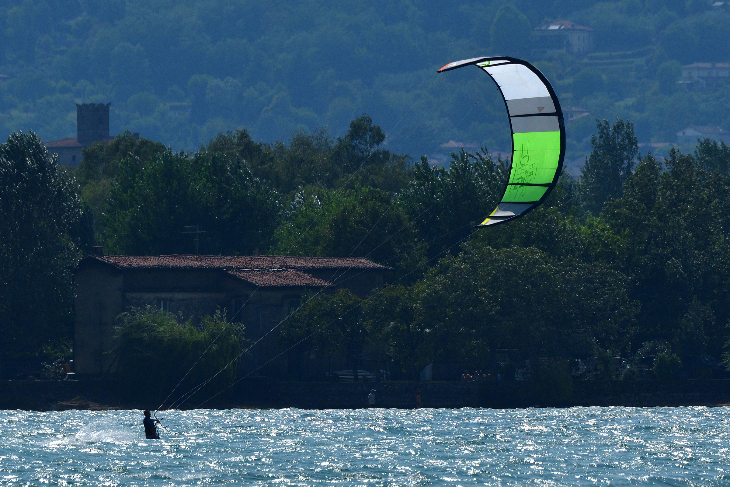 Iseo. If the wind lifts its voice the kitesurfing responds....
