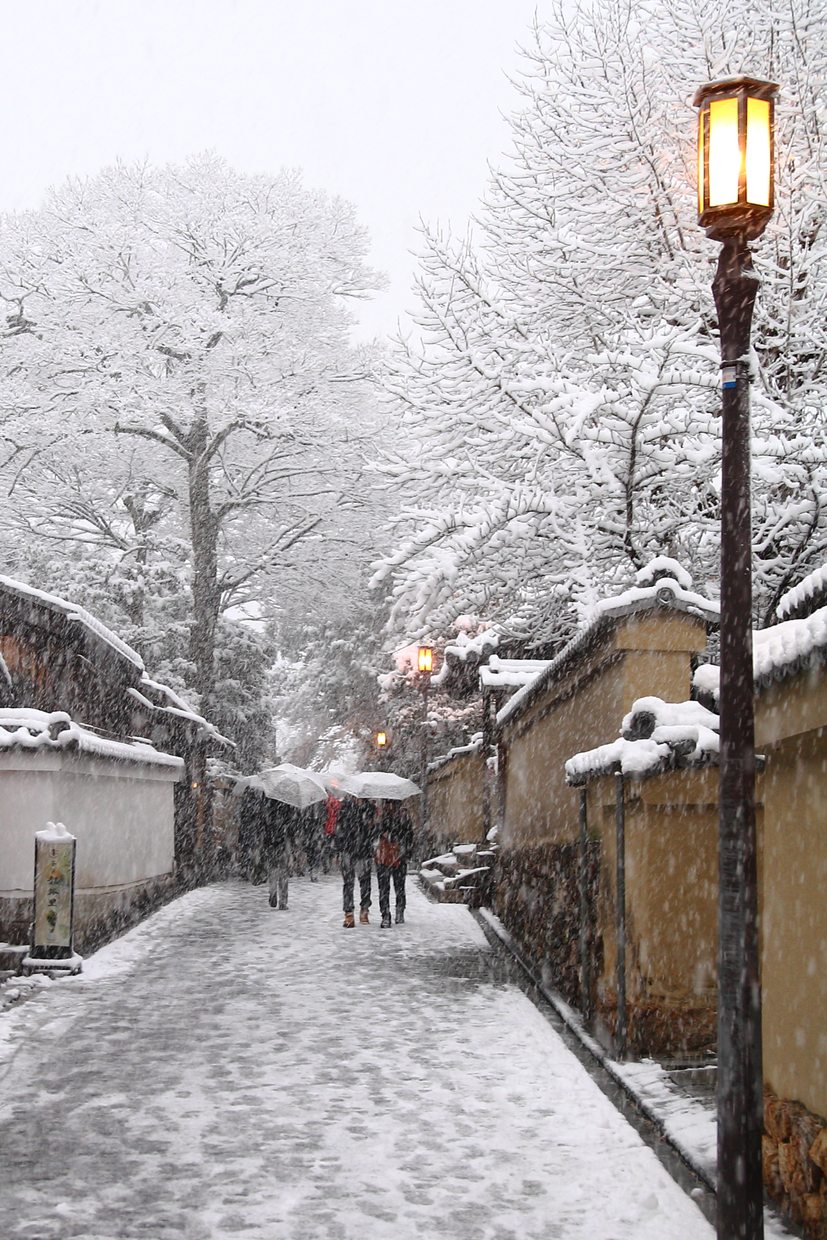 Kyoto in the Snow - The street lights come on...