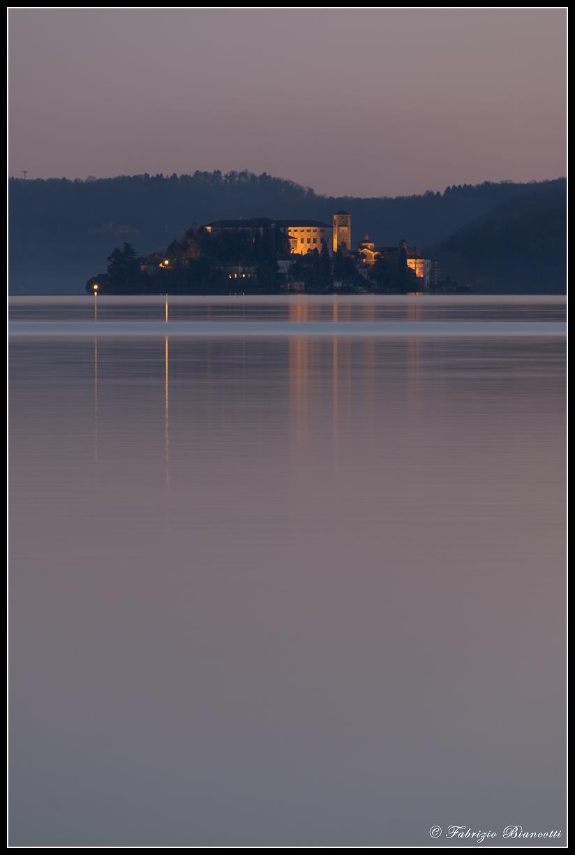 Island of San Giulio on a silk lake...