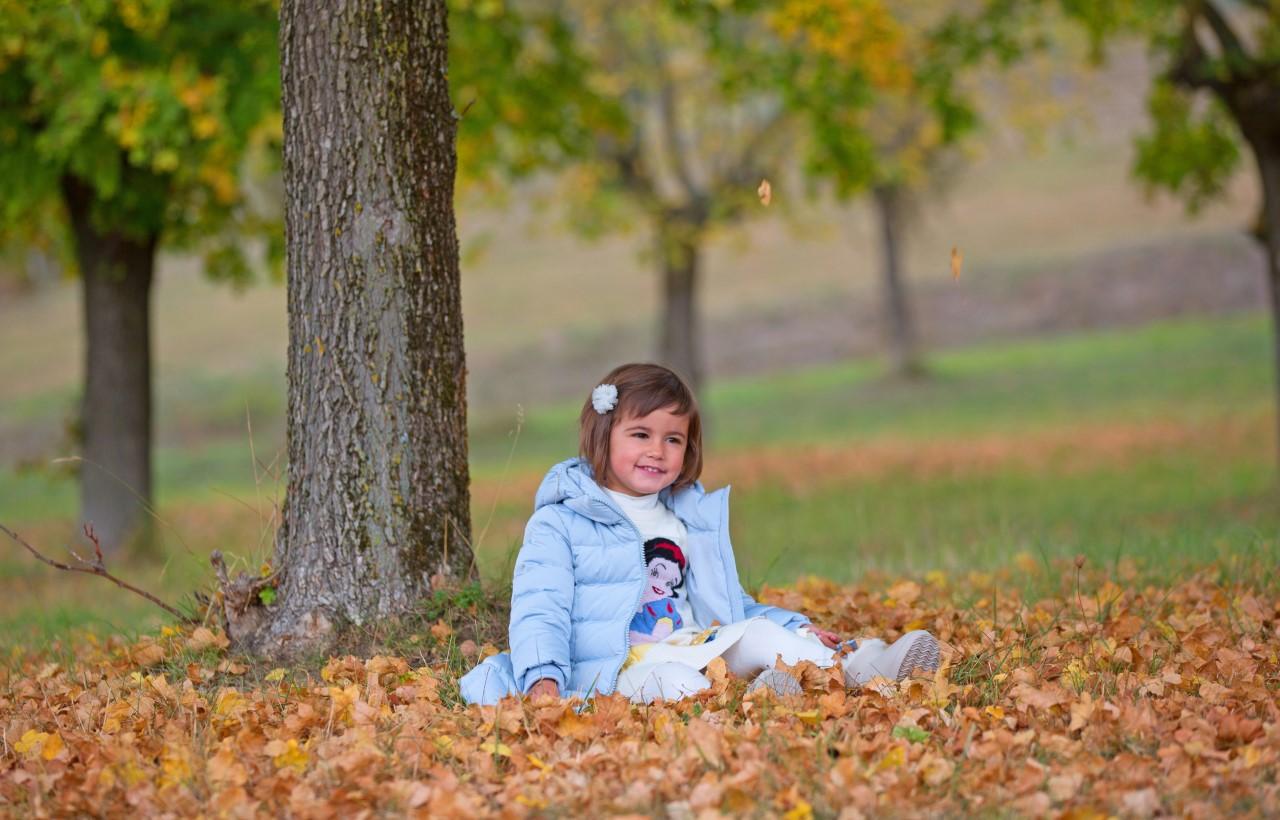 greta - granddaughter in the foliage...