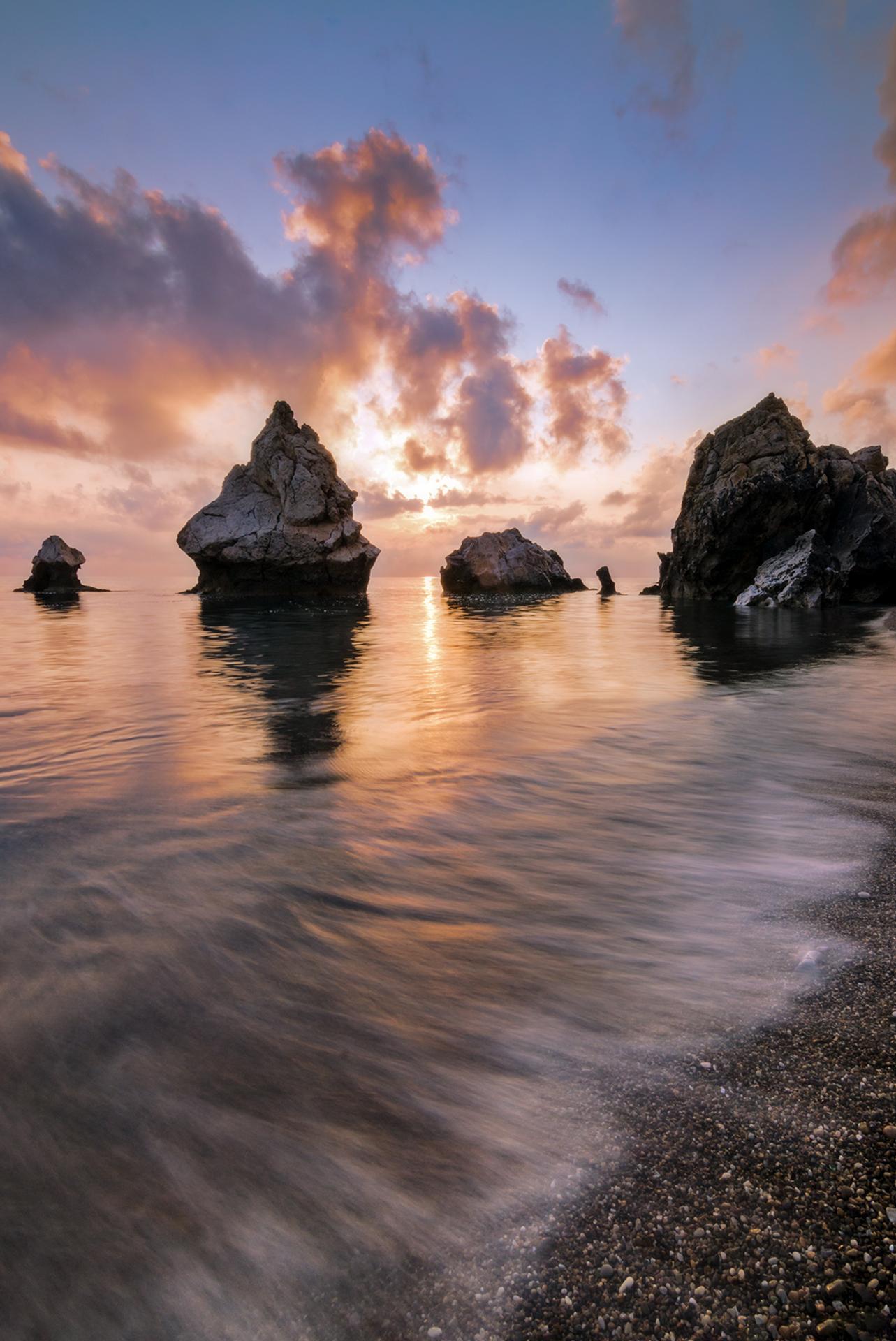Sunrise at the faraglioni...
